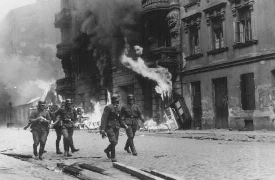 German soldiers burn residential buildings to the ground, one by one, during the Warsaw ghetto uprising. Poland, April 19-May 16, 1943.    http://www.ushmm.org/wlc/en/media_ph.php?ModuleId=10005188=735
