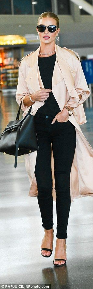 Rosie Huntington-Whiteley glides through LAX in a stunning light silk jacket | Daily Mail Online