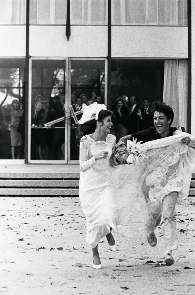 Benjamin (Dustin Hoffman) and Elaine (Katherine  Ross) make their getaway in The Graduate and leaving audiences to wonder what happens next @1978 Bob Willoughby/mptvimages.com