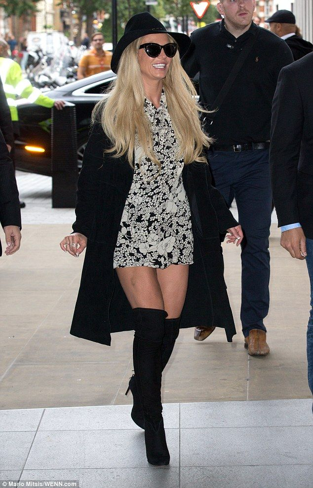 Blonde beauty:With her golden locks loose and tousled, she donned a black trilby that did little to calm her bouncy bouffant of a hairdo