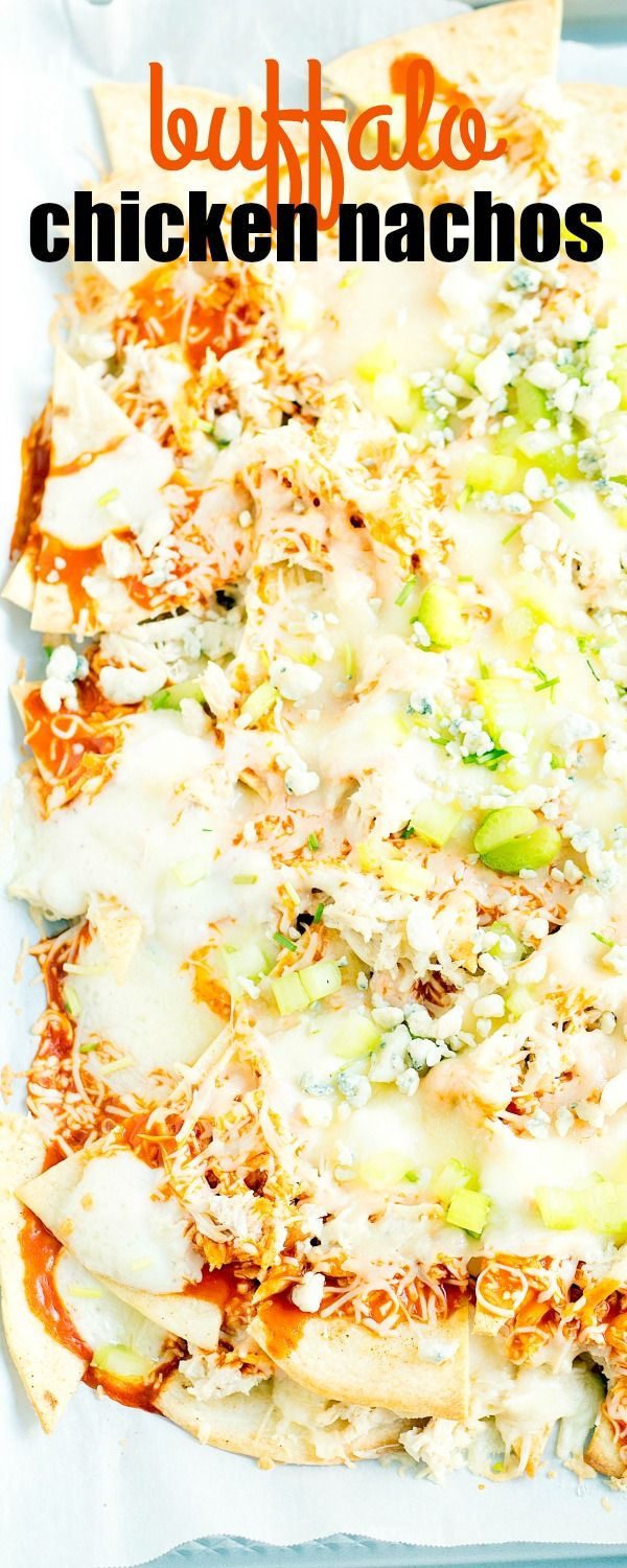 This easy sheet pan BUFFALO CHICKEN NACHOS recipe combines two game day favorites into one delicious bite! via @realhousemoms