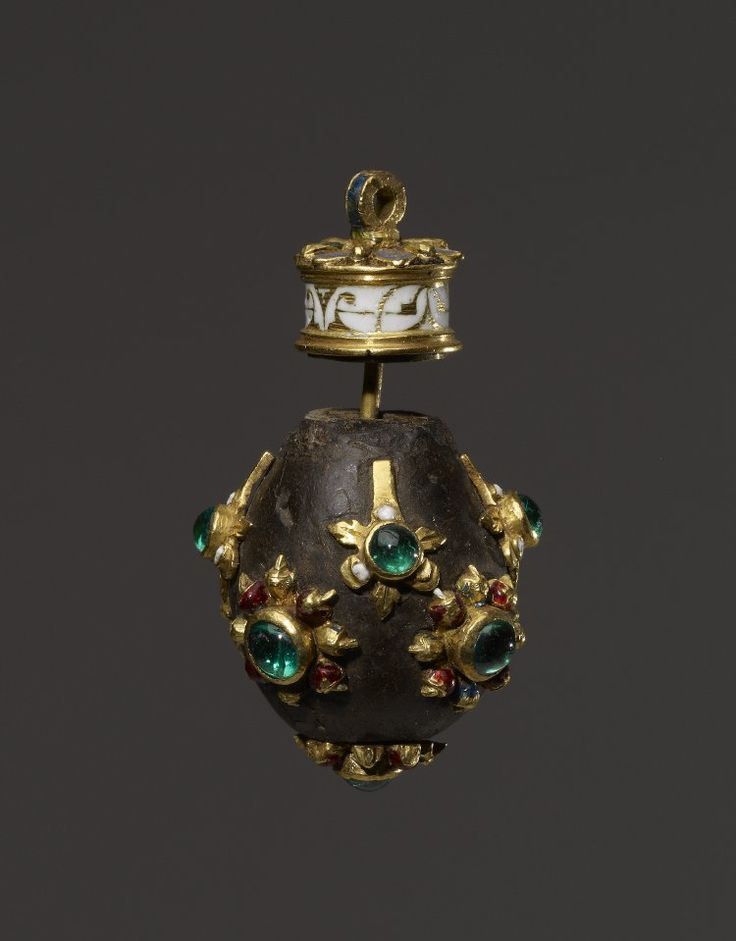 Pendant perfume-ball; gum benzoin(?) with enamelled gold mount; studded with emeralds. Made in Spain, ca. 1600.  Dimensions  Height: 4.4 centimetres  British Museum Registration number: AF.2863