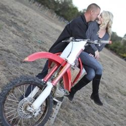 An engagement session featuring a dirt bike.