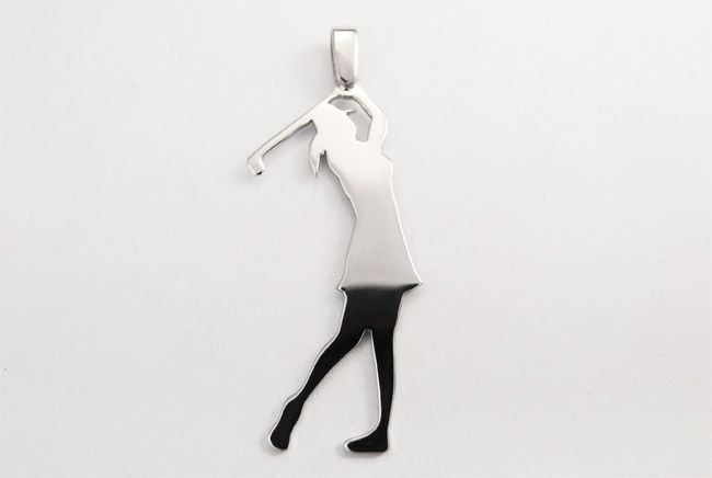 Silver pendant in a form of a golf player.