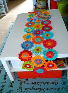 Fun and colorful crocheted flowers create a festive table runner!