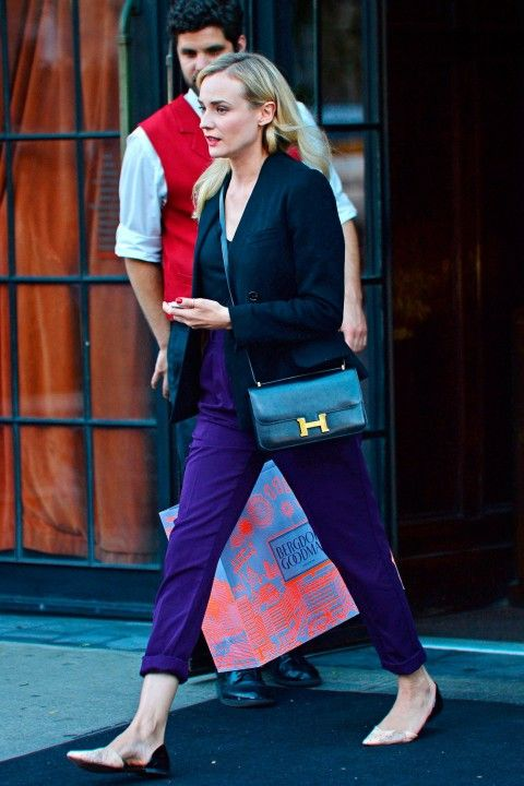 Diane Kruger is the epitomy of casual chic in New York in a black blazer, purple trousers and pointy pumps | Marie Claire