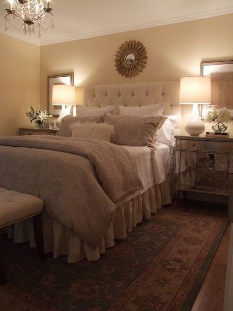 Neutral Bedroom, mirrored nightstands with mirrors behind them. Always like a chandelier in the bedroom by KimberleeA