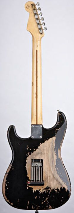 Blackie - Eric Clapton's main Stratocaster. I find this really insultingly ironic lol...but a beautiful relic.