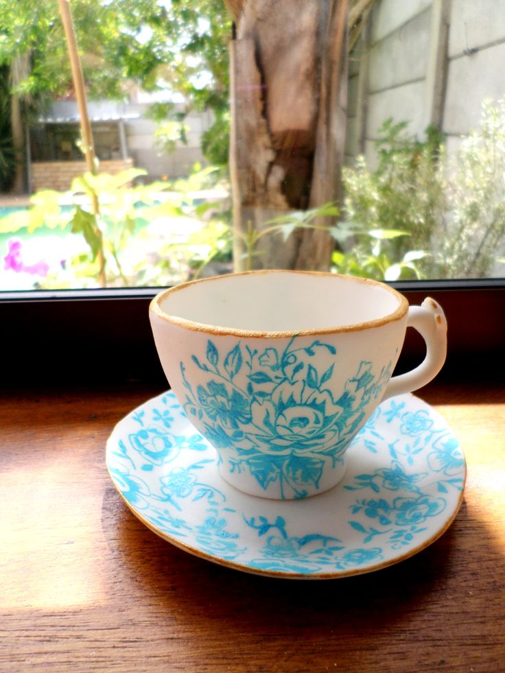sugar tea cup and saucer figurine