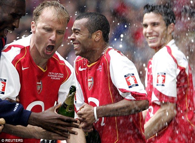 Arsenal legend Dennis Bergkamp celebrates with Ashley Cole and Robin van Persie in 2005