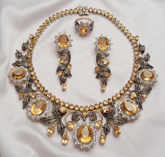 the Queen of Sheba Parure - large honey-colored diamonds, white brilliant-cut diamonds, smaller honey-coloured diamonds, rose-cut and old-cut diamonds set in yellow and white gold (some of which has been oxidized). It was designed specially for Lady Colin Campbell. The parure consists of a tiara, necklace, long-drop earrings, ring and bracelet.
