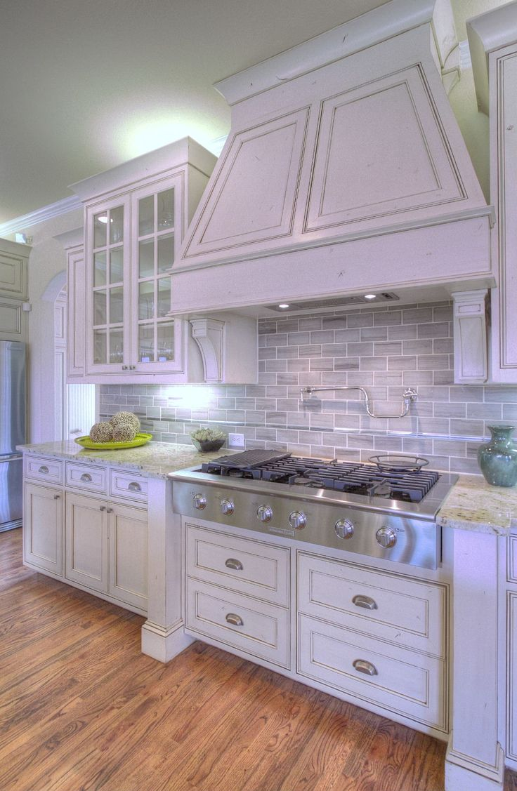 love the gray back splash with the white... so clean and pretty!