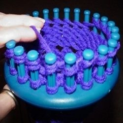 Here you will find a collection of free patterns to knit socks on the Knifty Knitter blue round loom. Socks with a toe, ribbed socks, or baby socks are just a few of the patterns you'll find. Knitting with the Knifty Knitter is easier than you might think. Create some cozy winter socks to keep the feet of a loved one warm this winter, OR whip up a special treat for your own feet!