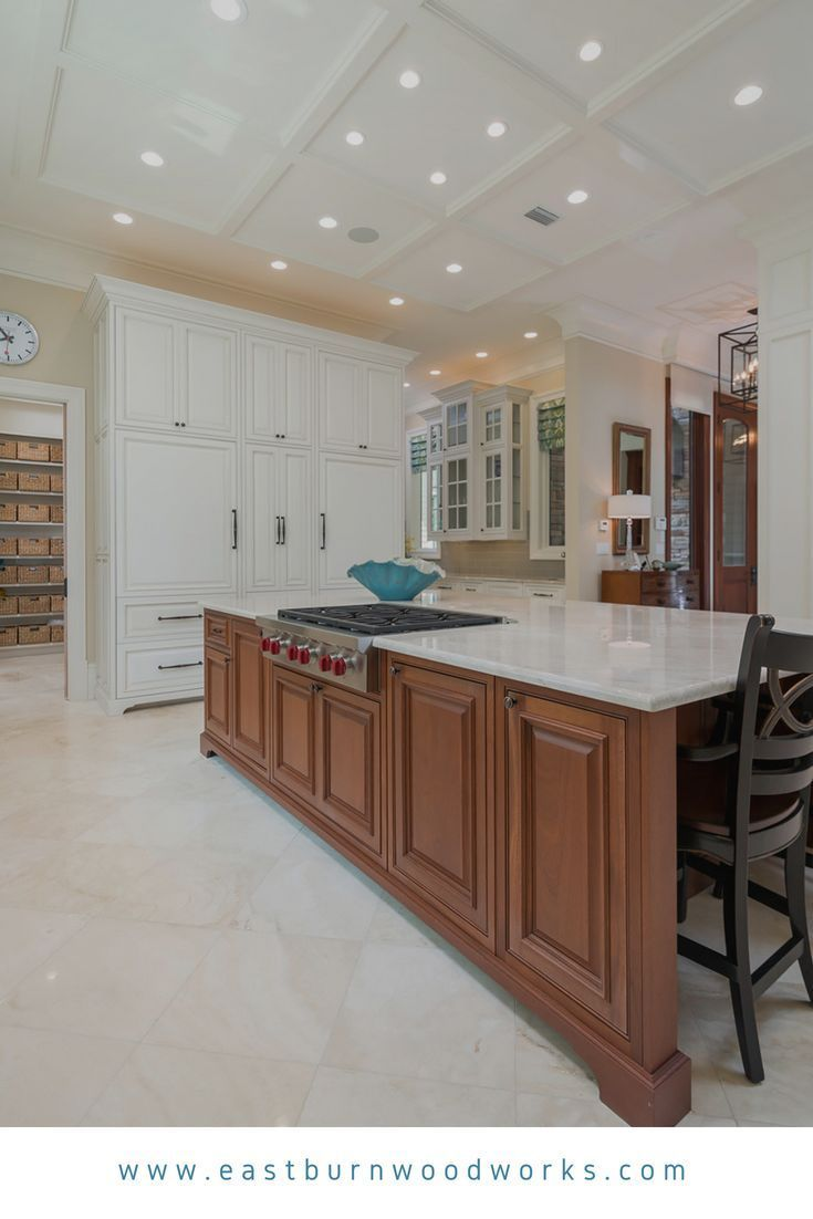 White Kitchen Cabinetry With Decorative Raised Panels And A Stained Kitchen Island Built By Eastburn Woodworks In Kitchen Inspirations Kitchen Cabinets Kitchen