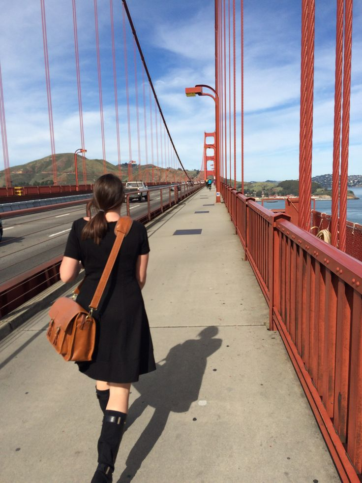 Ashley and her Kelly Moore Bag on the Golden Gate Bridge, just one of our packing essentials for six years on the road!