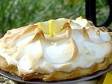 Lemon Meringue Pie- Paula Deen Tips by reviewers: use 3/4 c. lemon juice and add an extra egg yolk to the filling and bake the filling for 10-12  minutes before adding the meringue then bake for another 10 minutes *whip meringue in a glass bowl for best results