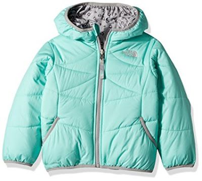 This North Face toddler girls' winter jacket is a versatile jacket that's crafted with varied insulation for optimal warmth and reverses from a smooth, water-repellent nylon side to a solid, quilted side. There is stretch binding on the hood, cuffs and hem for a perfect fit.