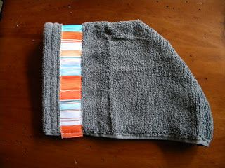 "You need a towel, hand towel and ribbon about 18"" long.     For the hood, cut the hand towel in half.     Sew the ribbon across the smooth..."