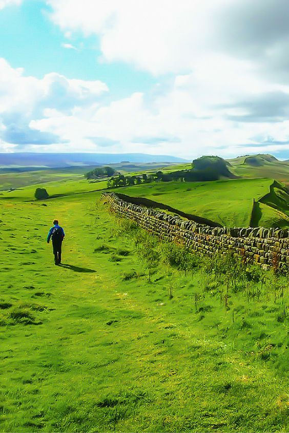 Hiking the magnificent Hadrian's Wall Path in Northumberland National Park, England.