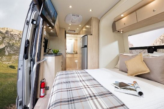 The 2015 Leisure Travel Vans Free Spirit SS Class B Motorhome  - Has my top 2 features: swivel front seats and large unobstructed view out the sliding van door. Plus it has a cool slide out. Sofa looks out the big open side door of the van. Great for ocean viewing!