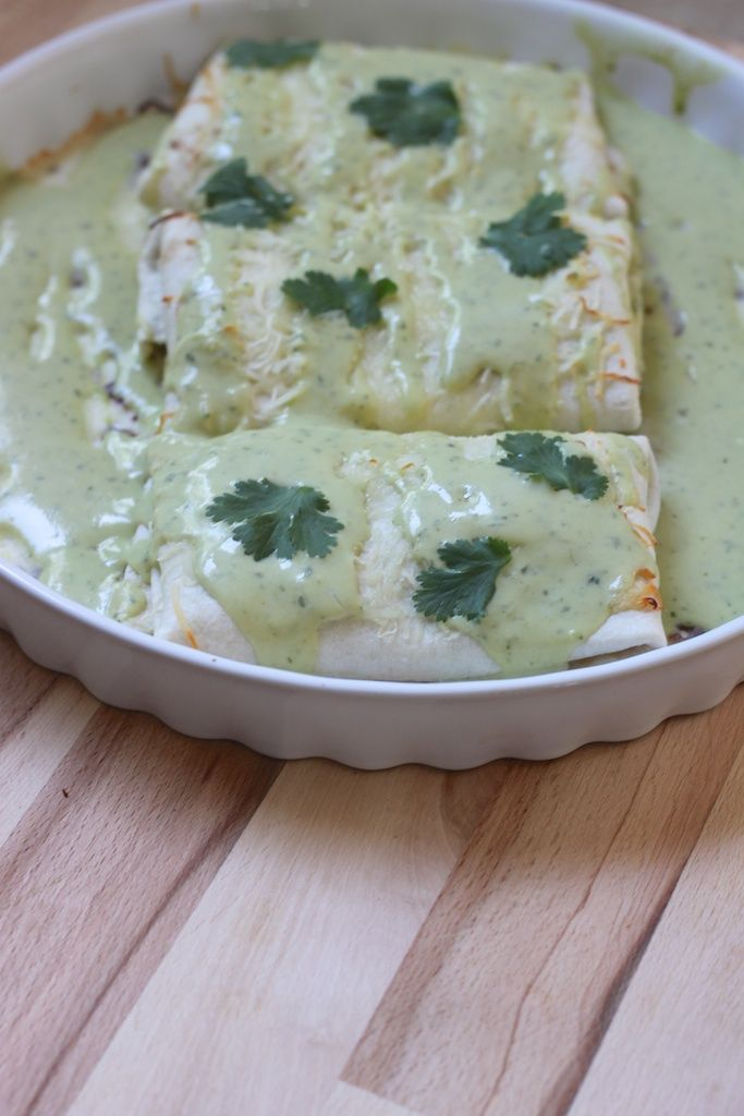 Chicken enchiladas with avocado cream sauce