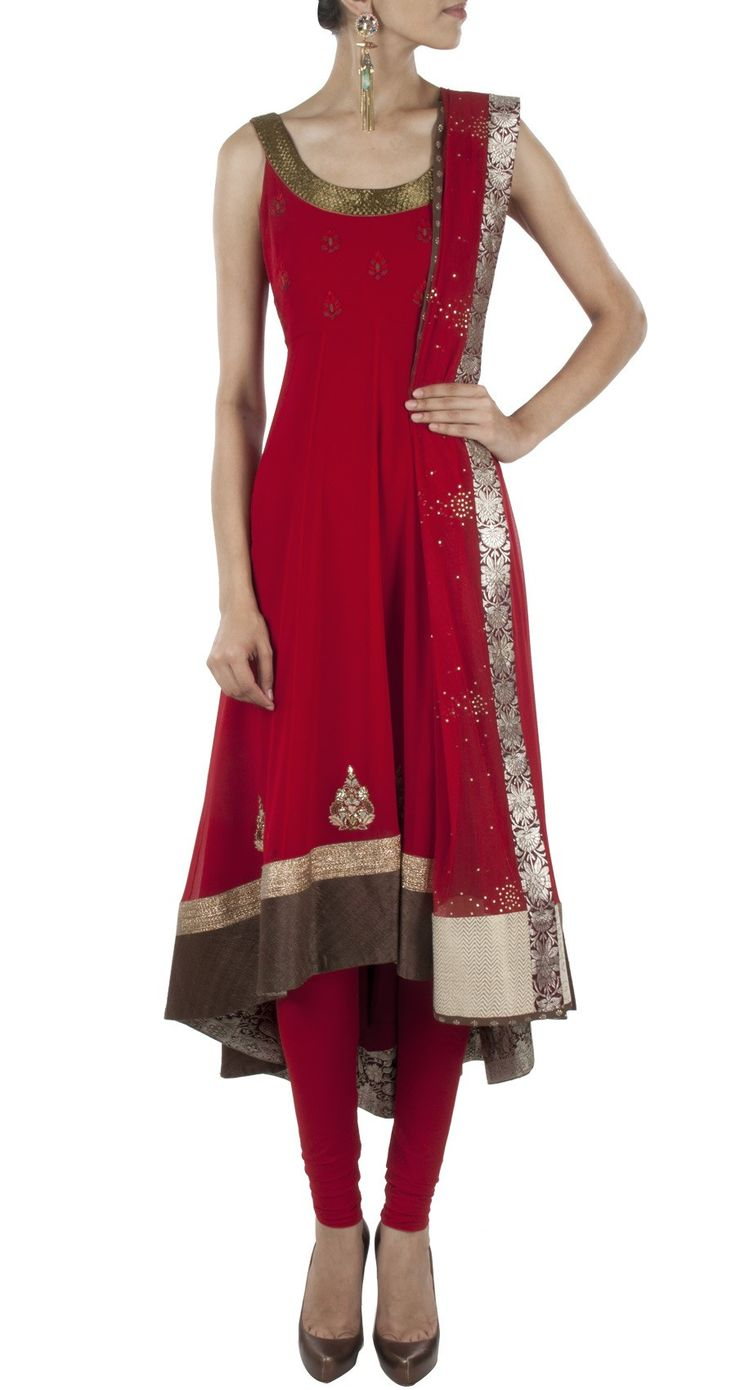 This anarkali suit is featuring a deep red georgette high and low hem kurta with dabka embroidery on the neckline. It features red booties on the yoke and a wid