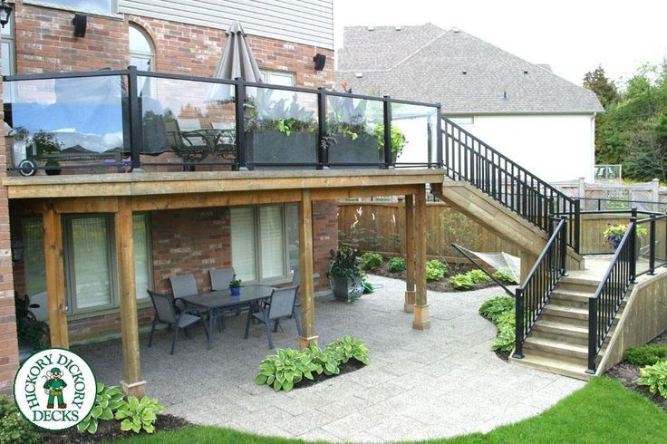 The elevated deck was built in Kitchner / Waterloo. The deck itself was constructed with cedar while the railings are aluminum with tempered glass inserts.