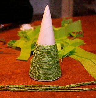 Use paper plates to make mini Christmas trees!