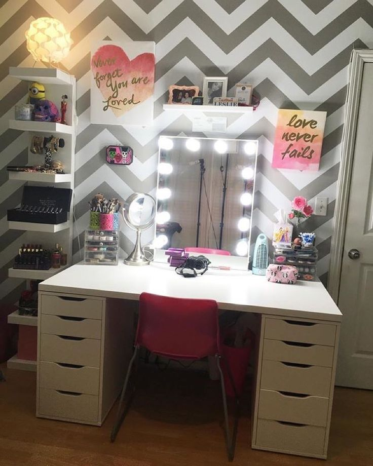 "This festive and absolutely chic vanity setup from @leslie_love features the Impressions Vanity Hollywood Glow XL with LED Bulbs. Repost @leslie_love: Finally put the finishing touches on my new vanity and I am IN LOVE! Bought two ""ALEX"" Drawer Units ($79 each) from IKEA along with the ""Linnmon"" Table Top ($29.99) and the ""LACK"" Wall  Shelf Unit ($49.99)... AMAZINGGGGGG vanity Mirror is from @impressionsvanity"