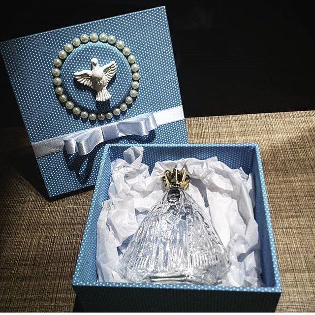 #mulpix Que luxo  essa Caixa com vidro de Nossa Senhora Aparecida com água benta…                                                                                                                                                                                 Mais