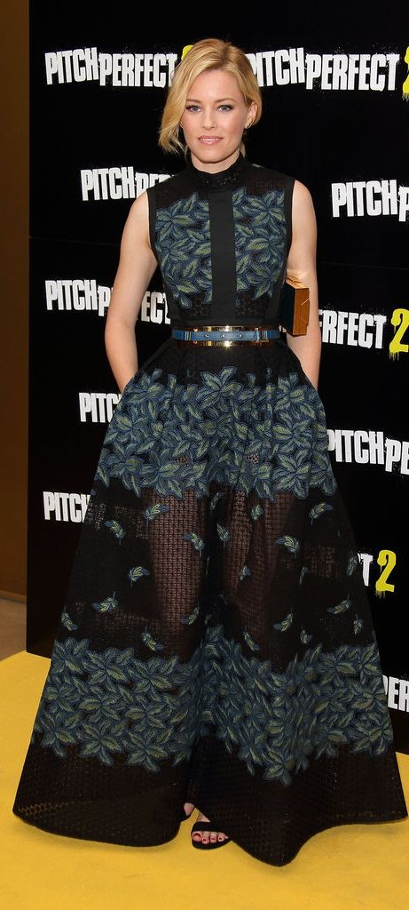 Elizabeth Banks is on a fashion roll! First she matched her costar, Rebel Wilson, at the Pitch Perfect 2 photocall, then she wore this Elie Saab dress at a VIP screening of the same film. This design in particular looks lovely on her — we love the belted waist and sheer insert!