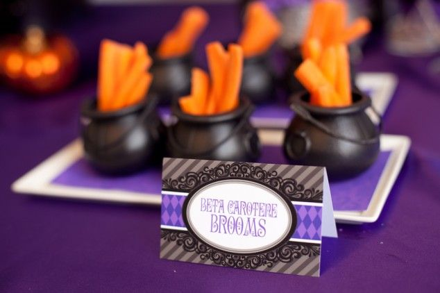 healthy Halloween snack: carrot sticks in black cauldrons filled with ranch dip