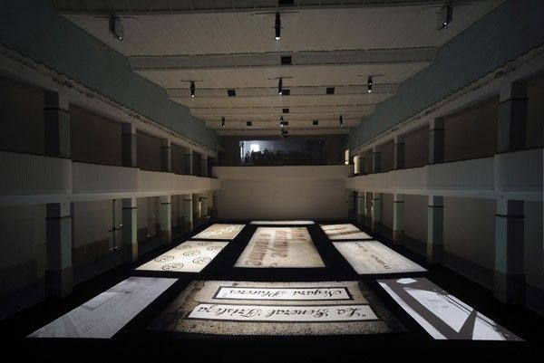 Carlos Garaicoa, Fin de Silencio/ End of Silence, 2010, Installation. 7 tapestries, 2 Mini DVD video transferred on DVD, ambient size; video 15' 45'' looped. Galleria Continua San Gimignano, 2015. Photo by Ela Bialkowska.