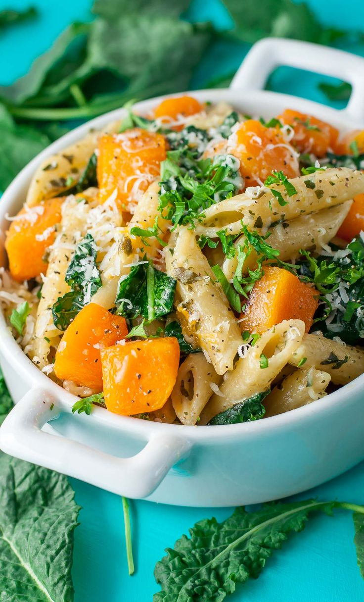 Tender penne pasta tossed with fresh pesto, roasted butternut squash, baby kale, and parmesan cheese. This healthy Pesto Penne with Roasted Butternut Squash and Kale is uber easy and full of flavor!