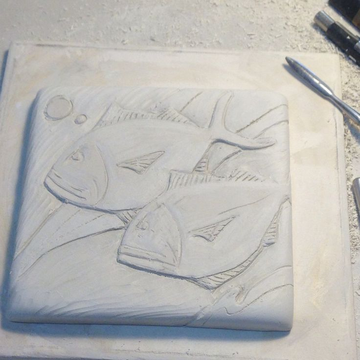 Porcelain tile with bas relief carving #workinprogress #inthestudio #pottery #annewebb