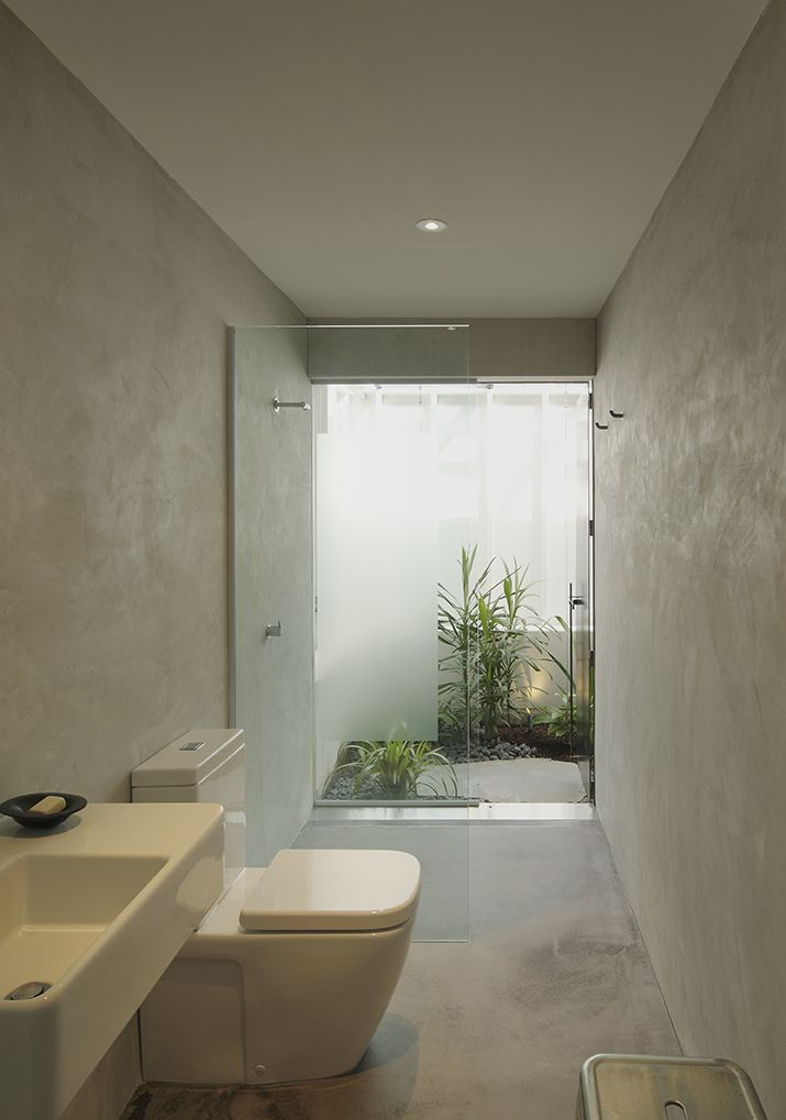 Chelmer House: Light filled bathroom with private courtyard. See more at http://blighgraham.com.au/projects/chelmer-house-2011