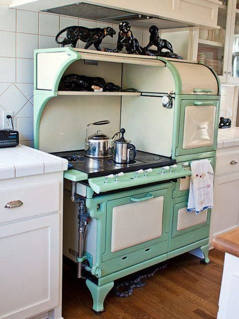 This fine antique stove/oven is in perfect condition.A 1920's model, it is mint green & white enamel outside and still has feet on which to stand,