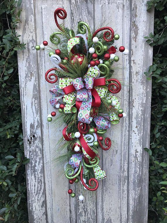 Whimsical Christmas Swag for door, Christmas Swag for Door, Christmas swag, Christmas swag and garland, Christmas Swag Wreath, Christmas Swags, Christmas Door swag Size 42X 18X 8 Christmas swag for your front door to welcome all your guests this Christmas. This whimsical Christmas swag