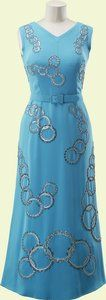 Turquoise silk crêpe evening gown worn by Queen Elizabeth II, designed by Norman Hartnell, English, 1976.