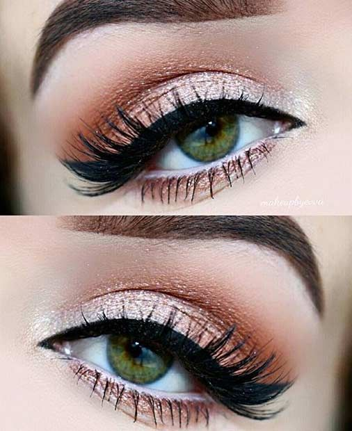 21. Neutral Eye Makeup Look If you're feeling a bare neutral vibe, go heavy with the eyelashes and have a champagne shade on your eyelids. It's almost bordering on silver. This is a classic and simple look, which will look amazing with any outfit. 22. Cop