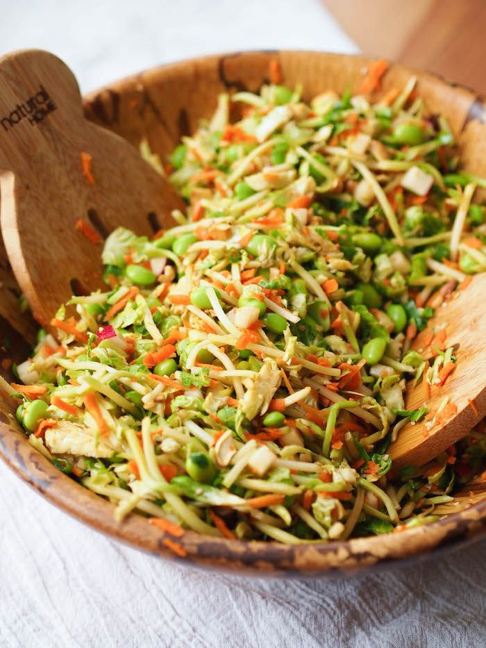 Crunchy Asian Edamame Slaw.  Simple uses bagged broccoli slaw and bagged shredded brussel sprouts from TJ.   Can add chicken if you want!!