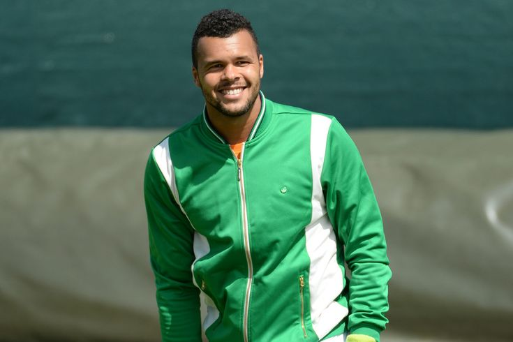 Practice week at Wimbledon 2014 - Day 2 Jo-Wilfried Tsonga is all smiles in practice