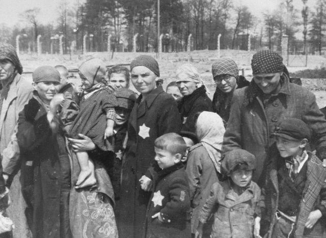 Jewish women and children walk to the gas chambers at the Auschwitz-Birkenau Extermination Camp.