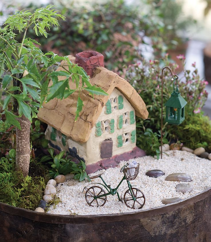 Jeremie | Miniature Garden Cottage, Bike And Green Lantern. Set In A  Jeremie Metal