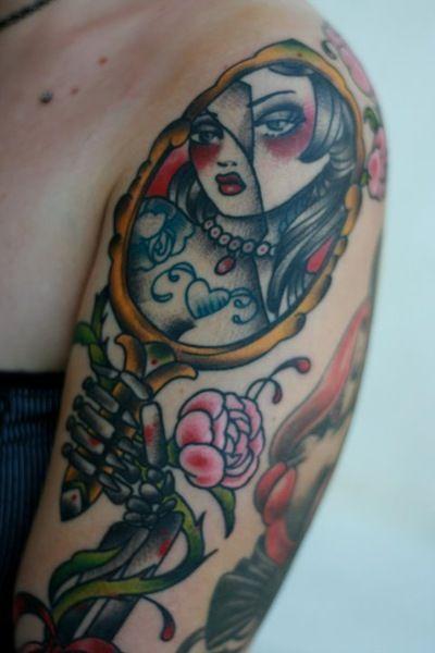 broken mirror skeleton hand lady portrait tattoo holding k69 mirror