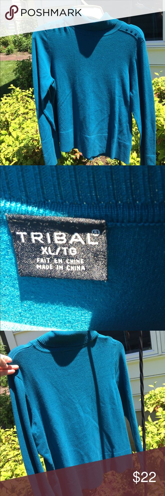 Tribal turtleneck sweater Turquoise blue Tribal sweater with four buttons at left of neckline and on each sleeve cuff are seven buttons. Small piece of one button on the sleeve has a small piece chipped off.No stains or tears. Smoke-free pet free home.Worn but in good condition. Tribal Sweaters Cowl & Turtlenecks