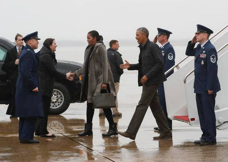 President Barack Obama, first lady Michelle Obama are greeted as they arrive on Air Force One, Monday, Jan. 2, 2017, in Andrews Air Force Base, Md., en route to Washington as they return from their annual vacation in Hawaii.