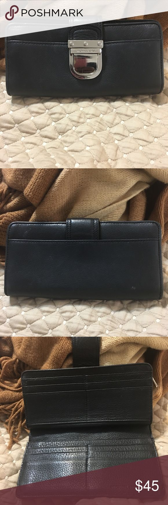 """Michael Kors Leather Wallet Michael Kors Wallet Color- Black Material- Soft Leather Hardware- Silver Length- 7.5"""" Height- 4"""" Features: -Buckle closure - 12 card slots - 4 slits for papers, documents, notes - 1 large opening for cash - 1 zip coin pouch - 1 back snap closure for any additional odds & ends - Open to Offers Michael Kors Bags Wallets"""