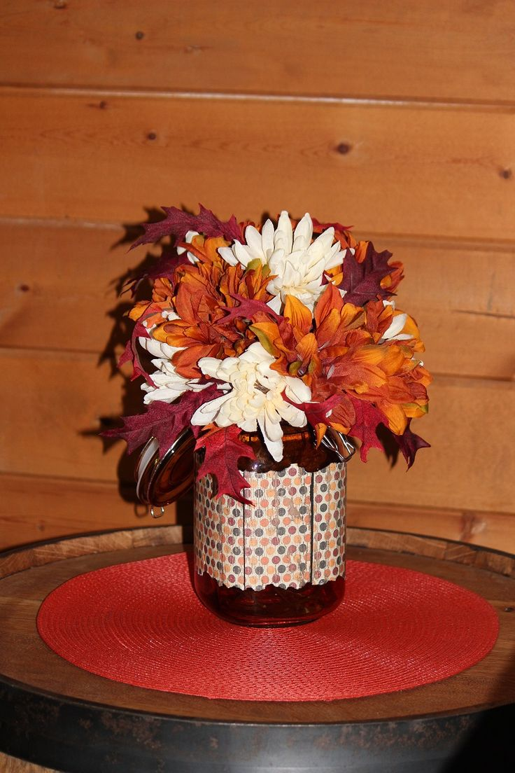 DIY Fall Flower Arrangement.  Easy and cheap flower arrangement.  All products in this arrangement were purchased from our local DG store.  Total cost, less than $2