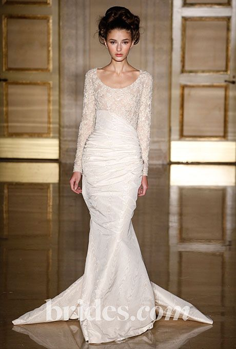 Brides.com: Wedding Dresses with Long Sleeves from the Bridal Runways Long-sleeved lace gown by Douglas Hannant  See more Douglas Hannant wedding dresses.Photo: George Chinsee